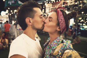 Couple kissing on the evening street during their first date
