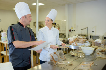 chef and commis baking bread in bakery