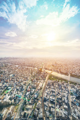 Fototapete - Asia Business concept for real estate and corporate construction - panoramic modern city urban skyline bird eye aerial view under sun & blue sky in Tokyo, Japan