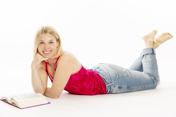 Young woman reading a book, isolated on a white background