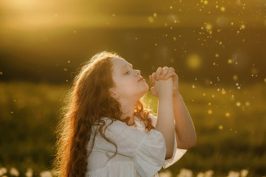 Little girl with praying. Peace, hope, dreams concept.
