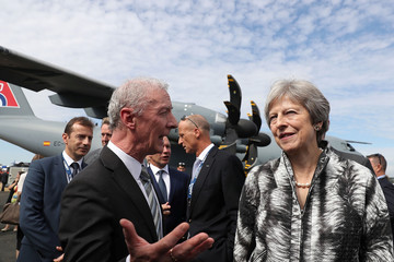 Britain's Prime Minister, Theresa May talks with guests as she arrives to open the Farnborough Airshow, in Farnborough