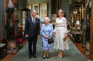 Britain's Queen Elizabeth stands with The King and Queen of the Belgians, Philippe of Belgium and Queen Mathilde in the Grand Corridor during their audience at Windsor Castle, Britain