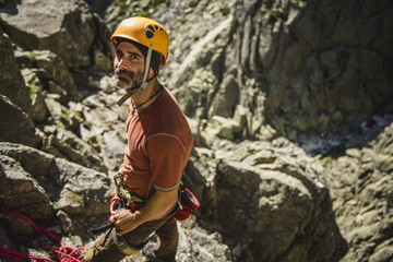Portrait of a climber wearing helmet ready to climb