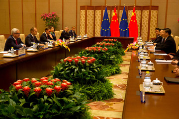 Chinese President Xi Jinping, meets with European Commission President Jean-Claude Juncker and European Council President Donald Tusk, during a meeting at the Diaoyutai State Guesthouse in Beijing