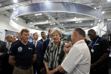 Britain's Prime Minister, Theresa May speaks with European Space Agency astronaut Tim Peake as she opens the Farnborough Airshow, in Farnborough