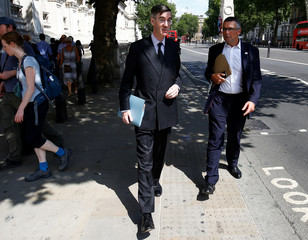 Member of Parliament, Jacob Rees-Mogg, walks along Whitehall, in central London