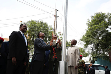 Eritrea's President Isaias Afwerki and Ethiopia's Prime Minister, Abiy Ahmed raise Eritrea's flag during a inauguration ceremony marking the reopening of the Eritrean embassy in Addis Ababa