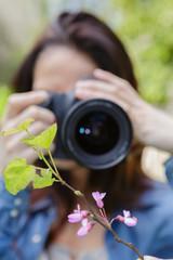 female photographer taking photos of nature