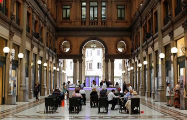 People eat breakfast in downtown Rome