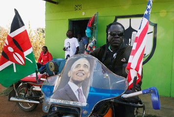 A resident seats on his motorbike ahead of the visit by the former U.S. President Barack Obama to his ancestral Nyangoma Kogelo village in Siaya county