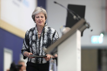 Britain's Prime Minister, Theresa May prepares to speaks at the Farnborough Airshow, in Farnborough