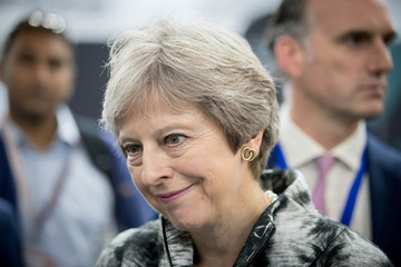 British Prime Minister Theresa May speaks with guests at the Farnborough Airshow, in Farnborough