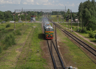 Train rides on rails at the station. Aerial view