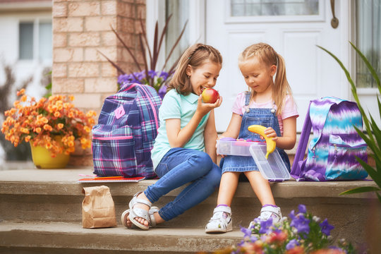 Girls eating fruit
