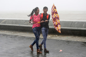 A couple share a moment on a rainy day in Mumbai