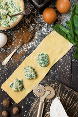 The process of making ravioli with ricotta, spinach and nutmeg