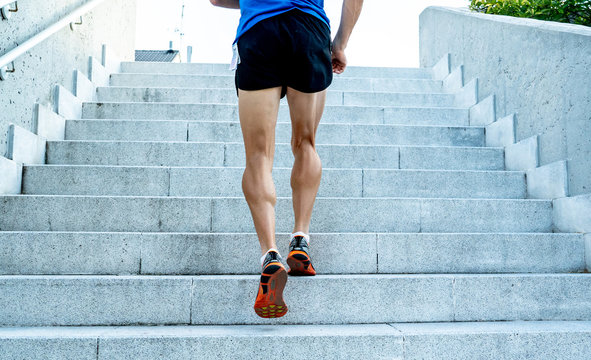 Close up of young man running up the stairs with running clothes