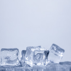 Cubes of ice covered with water drops. Frozen water in form of a cube, ice. Critically pure ice.