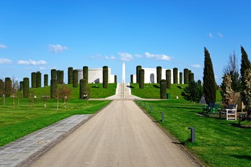 Road and steps leading to the front of the Armed Forces Memorial, National Memorial Arboretum, Alrewas, UK.