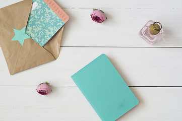 Notebook, envelope, calendar