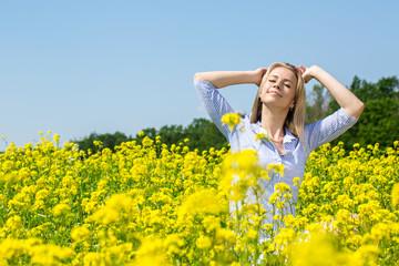 Woman enjoys the sun and nature