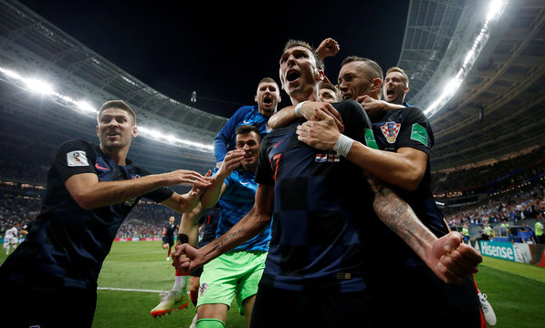 A Picture and its Story: Photographers' best World Cup shots