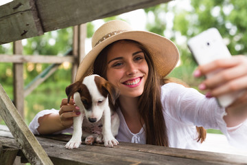 woman taking selfie photo with her pet