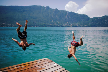 Boys jump into the Bourget Lake in Tresserve