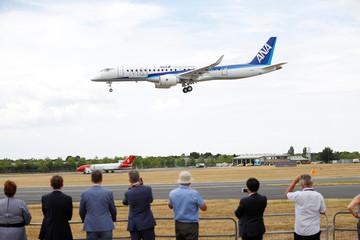 A Mitsubishi MRJ prepares to land after a display at the Farnborough Airshow, in Farnborough
