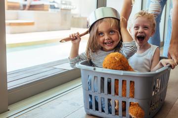 Fototapeta Kids rides in a laundry basket