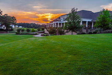 Sunset on Golf Course with Club House 18th Hole Wall mural