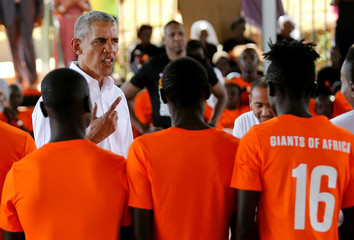 Former U.S. President Barack Obama addresses players at the basketball court during the launch of Sauti Kuu resource centre near his ancestral home in Nyangoma Kogelo village in Siaya county