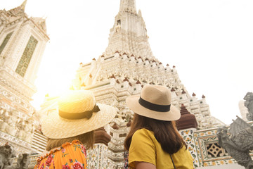Wall Mural - Tourists are traveling and sightseeing at Wat Arun temple in Bangkok during holiday summer vacation time.