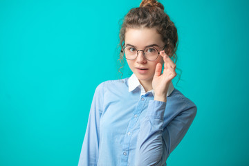close up photo of four eyes girl in blue and white shirt