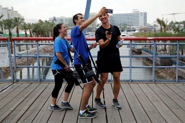 Israeli soldiers in civilian clothes take a selfie on the boardwalk in Eilat