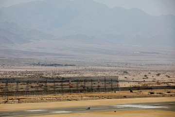 A general view of the security wall next to the runway of the new Ramon International Airport in Tina Valley, north to Eilat