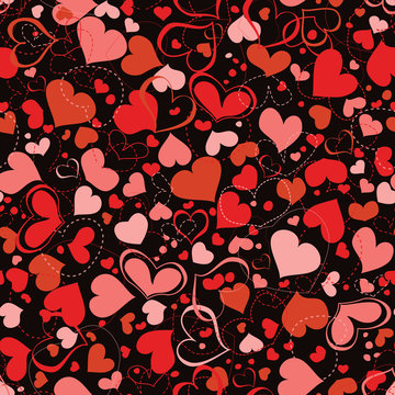 Red and pink hearts seamless pattern over dark background