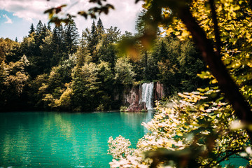 Majestic mountain waterfall and turquoise lake water.