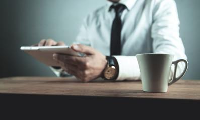 Businessman using white digital tablet.