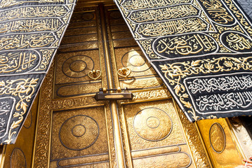 MECCA, SAUDI ARABIA - MAY 01 2018: The golden doors of the Holy Kaaba closeup, covered with Kiswah. Massive lock on the doors. Entrance to the Kaaba in Masjid al Haram Wall mural