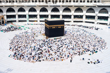 MECCA, SAUDI ARABIA - MAY 05 2018: Prayer time Asr in Mecca. People making salat or salah around Holy Kaaba. Photo taken during the praying at position Sujood from the top of Al Masjid Al Haram Mosque