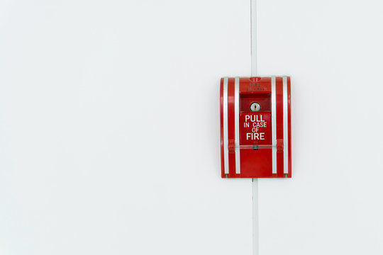 fire alarm switch on the white wall, use in case of fire