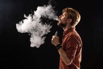 A young man with a beard and a stylish hairstyle in a shirt, smoking a cigarette, a viper, a room, a studio, smoke, enjoyment