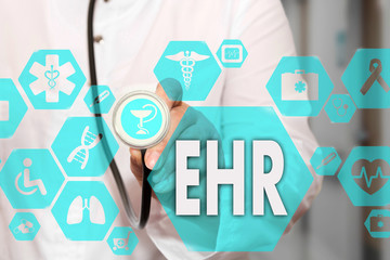 Electronic health record. EHR on the touch screen with medicine icons on the background blur Doctor in hospital.Innovation treatment, service, data analysis health. Medical Healthcare Concept EHR