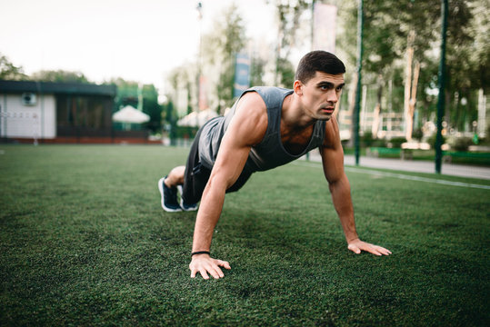 Athlete doing push-up exercise on outdoor workout
