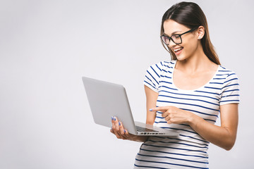 Portrait of happy wow young beautiful smiling woman standing with laptop isolated on white background. Space for text.