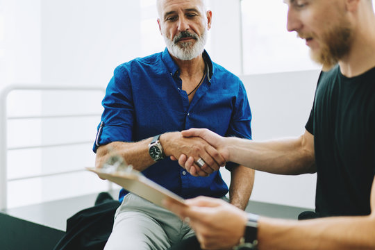 Young entrepreneur in casual clothes shake hands with the investor who gived a positive answer for the new start up investment for a project.Business partners shaking hands as they closing a good deal