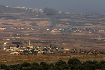 Smoke following an explosion in Syria is seen from the Israeli-occupied Golan Heights near the Israeli Syrian border