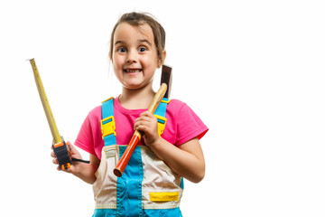 Portrait of a girl builder with a hammer on her shoulder isolated on white background